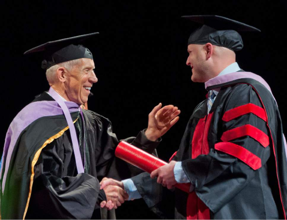Michael Mangum  |  Special to the Tribune Associate Dean Glen R. Hanson presents Brett Kocherhans receives his diploma during the University of Utah School of Dentistry inaugural commencement ceremonies at Kingsbury Hall on Saturday, May 20th, 2017.