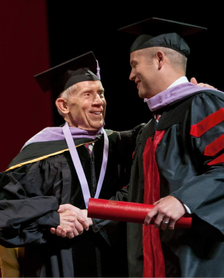 Michael Mangum  |  Special to the Tribune Associate Dean Glen R. Hanson presents Colby Broadbent with his diploma during the University of Utah School of Dentistry inaugural commencement ceremonies at Kingsbury Hall on Saturday, May 20th, 2017.