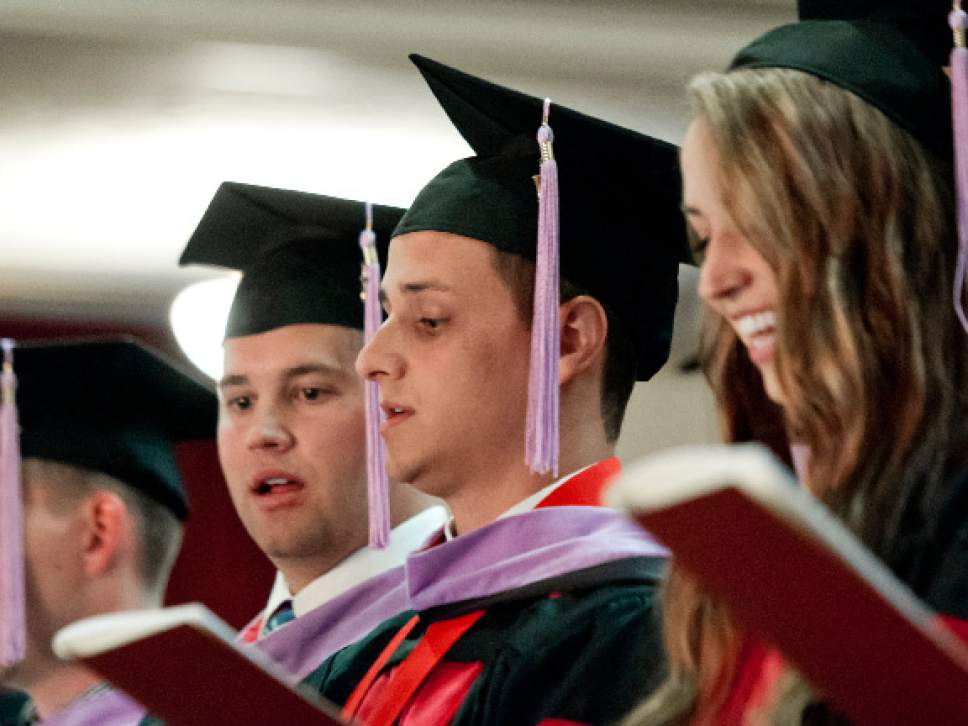Michael Mangum     Special to the Tribune Graduating students recite the Oath of Hippocrates during the University of Utah School of Dentistry inaugural commencement ceremonies at Kingsbury Hall on Saturday, May 20th, 2017.