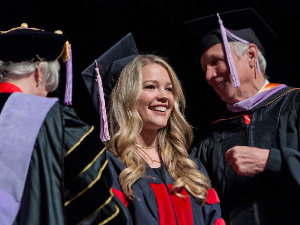Michael Mangum  |  Special to the Tribune Rachel Smith receives her doctoral hood during the University of Utah School of Dentistry inaugural commencement ceremonies at Kingsbury Hall on Saturday, May 20th, 2017.