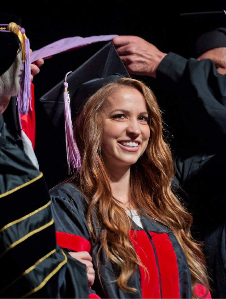 Michael Mangum     Special to the Tribune Kathryn Cameron receives her doctoral hood during the University of Utah School of Dentistry inaugural commencement ceremonies at Kingsbury Hall on Saturday, May 20th, 2017.