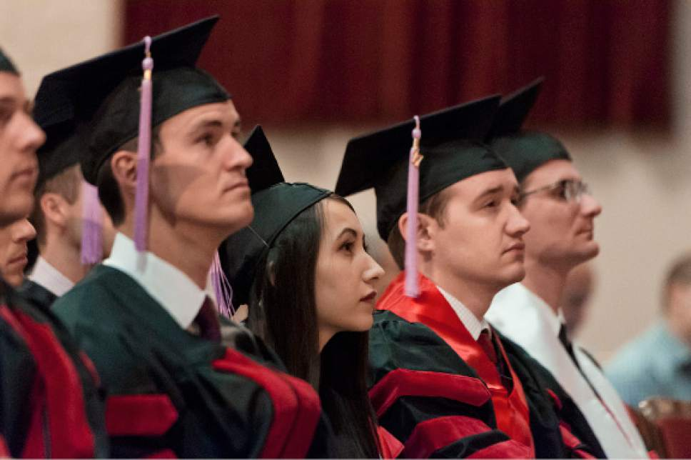 Michael Mangum  |  Special to the Tribune University of Utah School of Dentistry students listen to the keynote address during the school's inaugural commencement ceremonies at Kingsbury Hall on Saturday, May 20th, 2017.