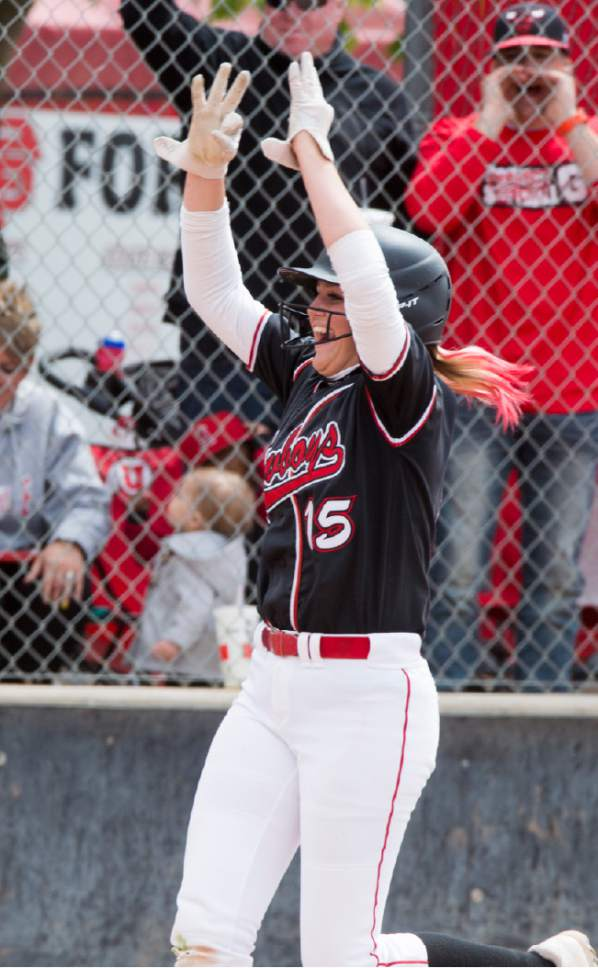 Rick Egan  |  The Salt Lake Tribune  Hannah Butler celebrates her home run for the Grantsville Cowboys, giving them a 4-1 victory over the Ridgeline Riverhawks, in the Class 3A softball state semifinals, Grantsville Vs. Ridgeline, Friday, May 19, 2017.