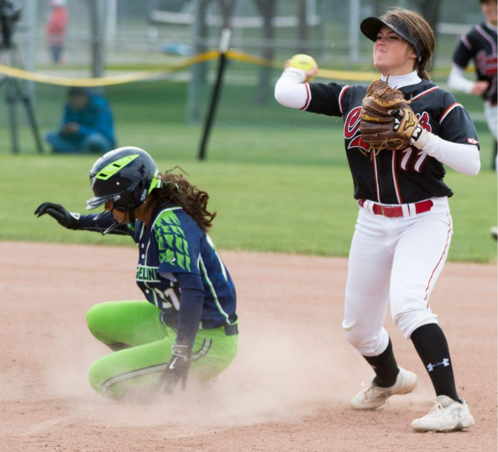 Rick Egan  |  The Salt Lake Tribune  Grantsville second baseman Maizie Clark (11) throws to first after tagging out Ridgeline Riverhawks runner Islay May Kekauoha , in the Class 3A softball state semifinals, Grantsville Vs. Ridgeline, Friday, May 19, 2017.