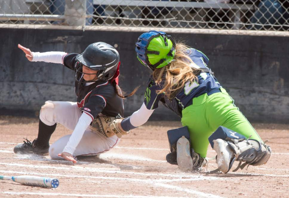 Rick Egan  |  The Salt Lake Tribune  Alyssa Gonzales (3) Grantsville, slides safely into home as Lyndsey Anderson (21) puts on the tag, for the Ridgeline Riverhawks, in the class 3A softball state semifinals, Grantsville Vs. Ridgeline, Friday, May 19, 2017.