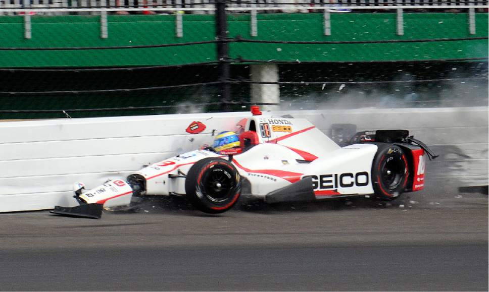 auto racing sebastien bourdais crashes at indy taken off on backboard the salt lake tribune. Black Bedroom Furniture Sets. Home Design Ideas