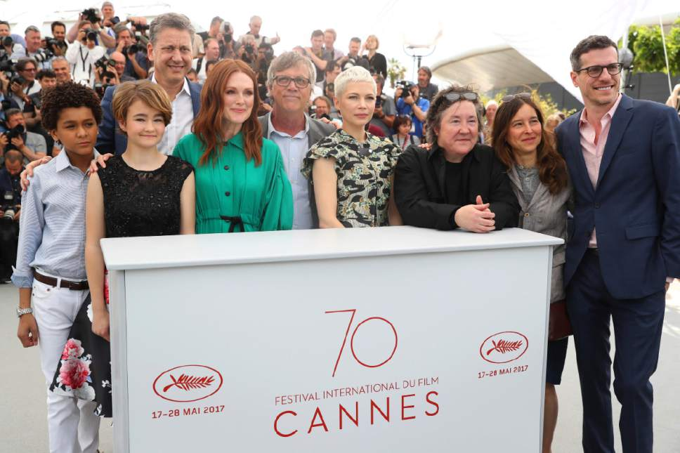 Actors Jaden Michael, from left, Millicent Simmonds, producer John Sloss, director Todd Haynes, actress Michelle Williams, producers Christine Vachon, Pamela Koffler and author Brian Selznick pose for photographers during the photo call for the film Wonderstruck at the 70th international film festival, Cannes, southern France, Thursday, May 18, 2017. (AP Photo/Alastair Grant)