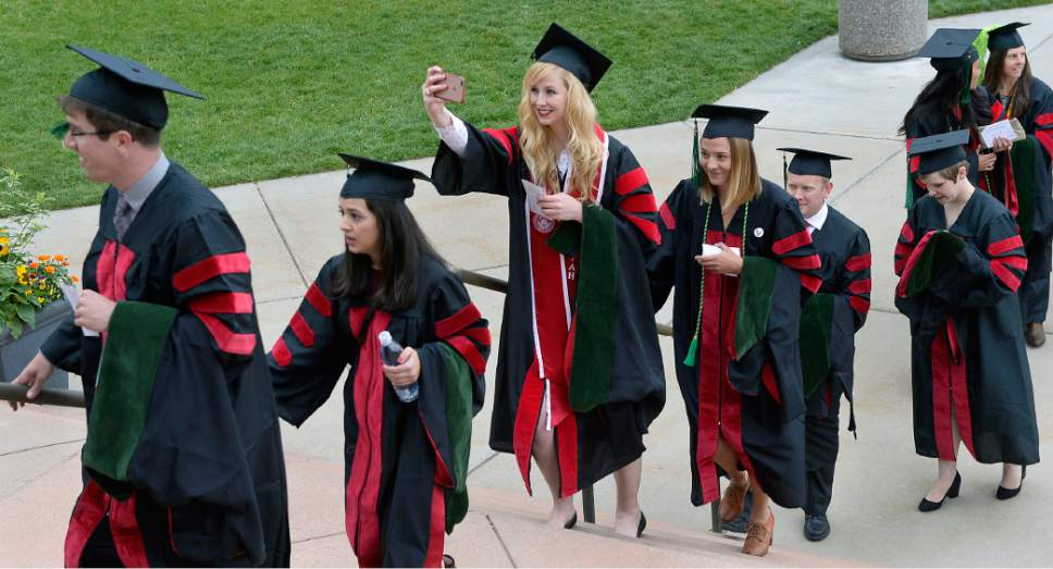 Al Hartmann  |  The Salt Lake Tribune Spirits were high as University of Utah  School of Medicine graduates march into Kinsbury Hall Friday May 19 for commencement.  With 297 students graduating it's the first expanded class size from the passage of Senate Bill 42 in 2013.