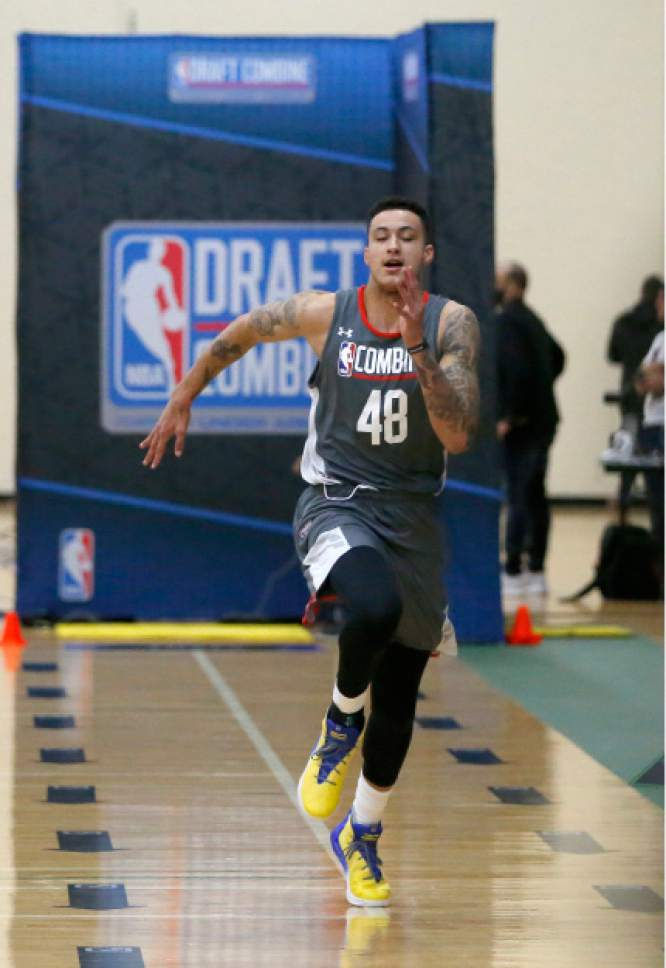 Kyle Kuzma, from Utah, participates in the sprint drill at the NBA draft basketball combine Thursday, May 11, 2017, in Chicago. (AP Photo/Charles Rex Arbogast)