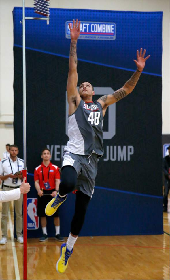 Kyle Kuzma, from Utah, participates in the running vertical jump at the NBA draft basketball combine Thursday, May 11, 2017, in Chicago. (AP Photo/Charles Rex Arbogast)