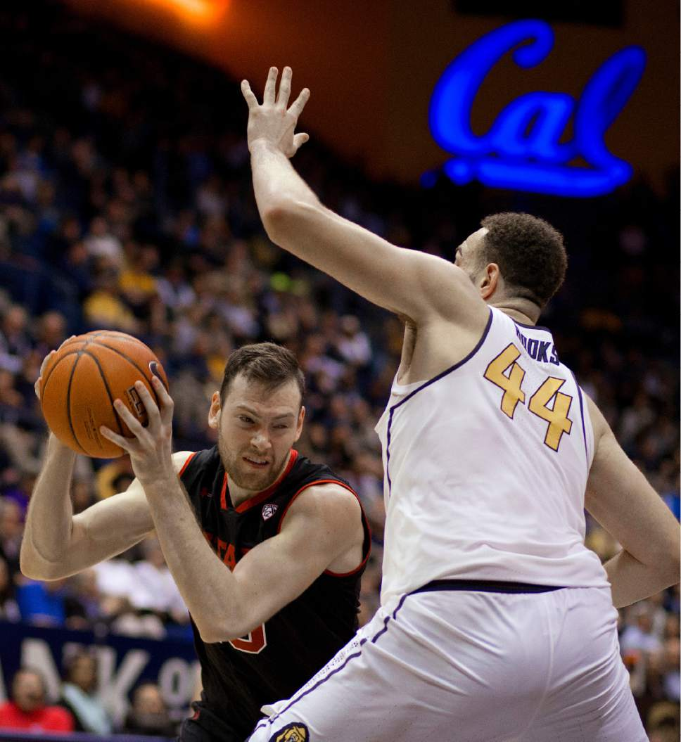 Utah's David Collette, left, looks for a way around California's Kameron Rooks (44) during the second half of an NCAA college basketball game Thursday, Feb. 2, 2017, in Berkeley, Calif. (AP Photo/Ben Margot)