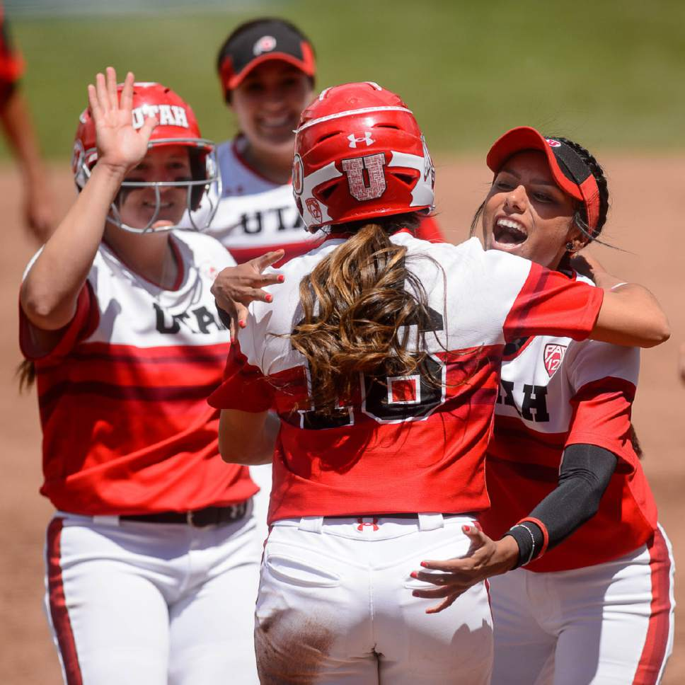 Trent Nelson  |  The Salt Lake Tribune Utah outfielder Alyssa Barrera (16) and Utah infielder Delilah Pacheco (4) embrace after a run as Utah faces BYU in the final of the Salt Lake City Regional, NCAA softball at Dumke Family Softball Stadium, Saturday May 20, 2017.
