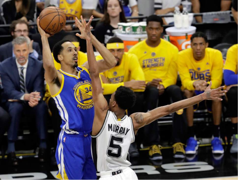 Golden State Warriors guard Shaun Livingston (34) goes up for a shot as San Antonio Spurs' Dejounte Murray (5) defends during the first half in Game 4 of the NBA basketball Western Conference finals, Monday, May 22, 2017, in San Antonio. (AP Photo/Eric Gay)