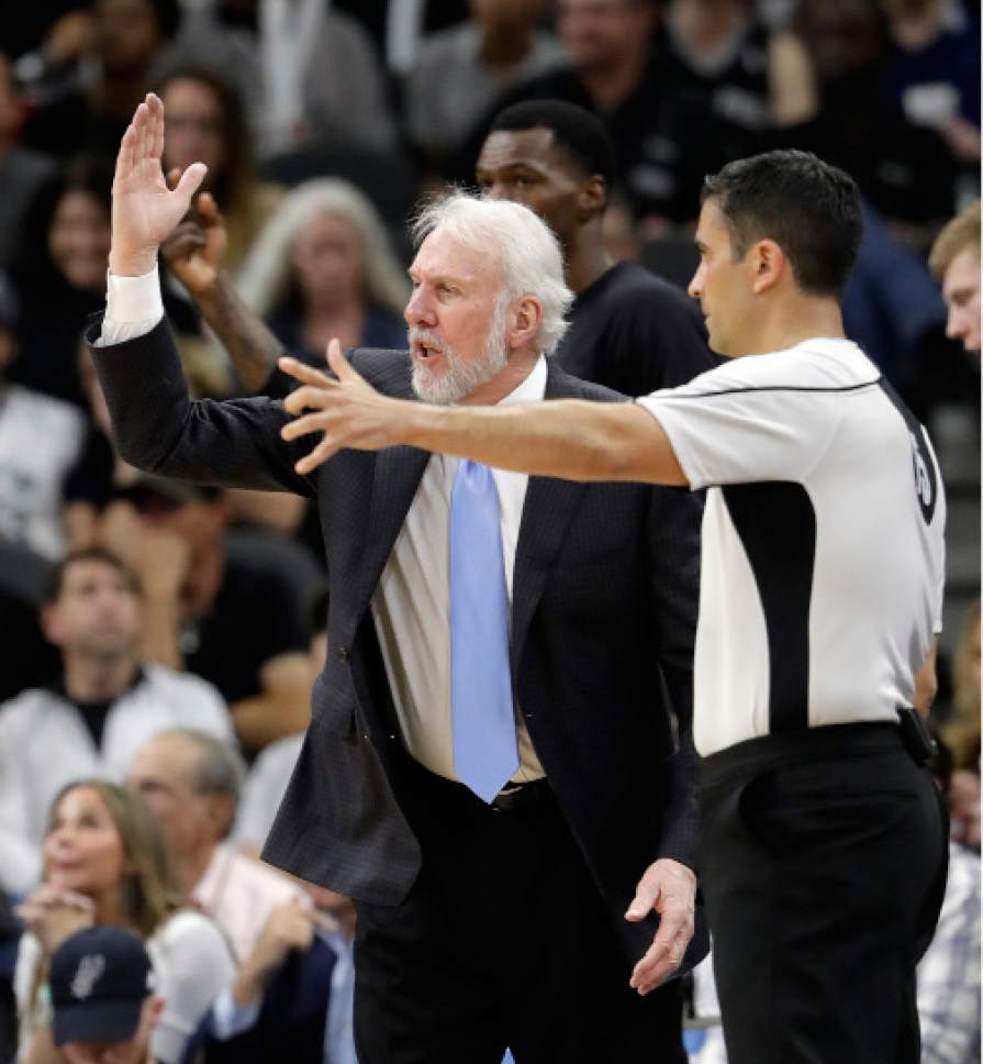 San Antonio Spurs head coach Gregg Popovich gestures as he talks to an official during the second half in Game 4 of the NBA basketball Western Conference finals against the Golden State Warriors on Monday, May 22, 2017, in San Antonio. (AP Photo/Eric Gay)