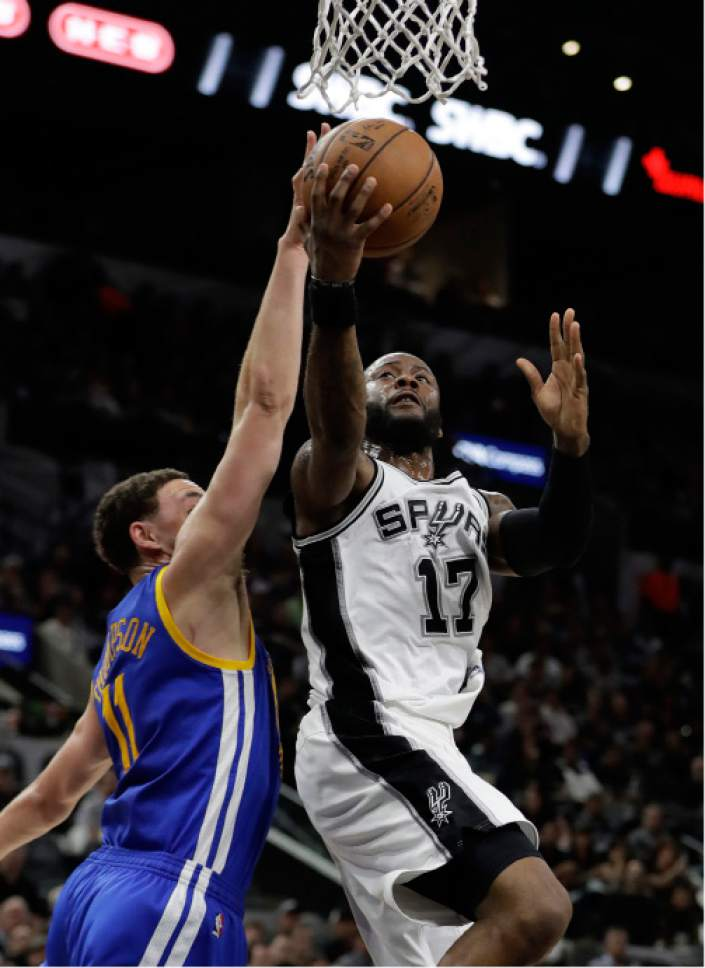 Golden State Warriors' Klay Thompson (11) defends as San Antonio Spurs' Jonathon Simmons (17) goes up for a shot during the second half in Game 4 of the NBA basketball Western Conference finals, Monday, May 22, 2017, in San Antonio. (AP Photo/Eric Gay)