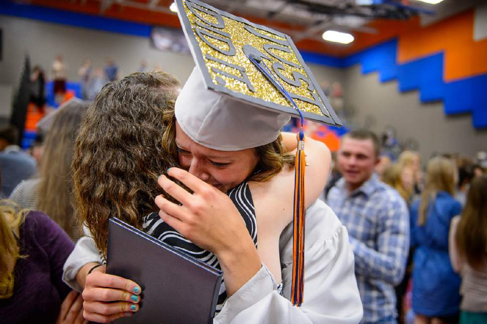Trent Nelson  |  The Salt Lake Tribune Water Canyon High School graduate Danielle Barlow breaks down in tears in the arm of a friend, Paula Barlow, after a graduation ceremony in Hildale, Monday May 22, 2017. Barlow is the 13th of 16 children, and the first to earn a high school diploma.