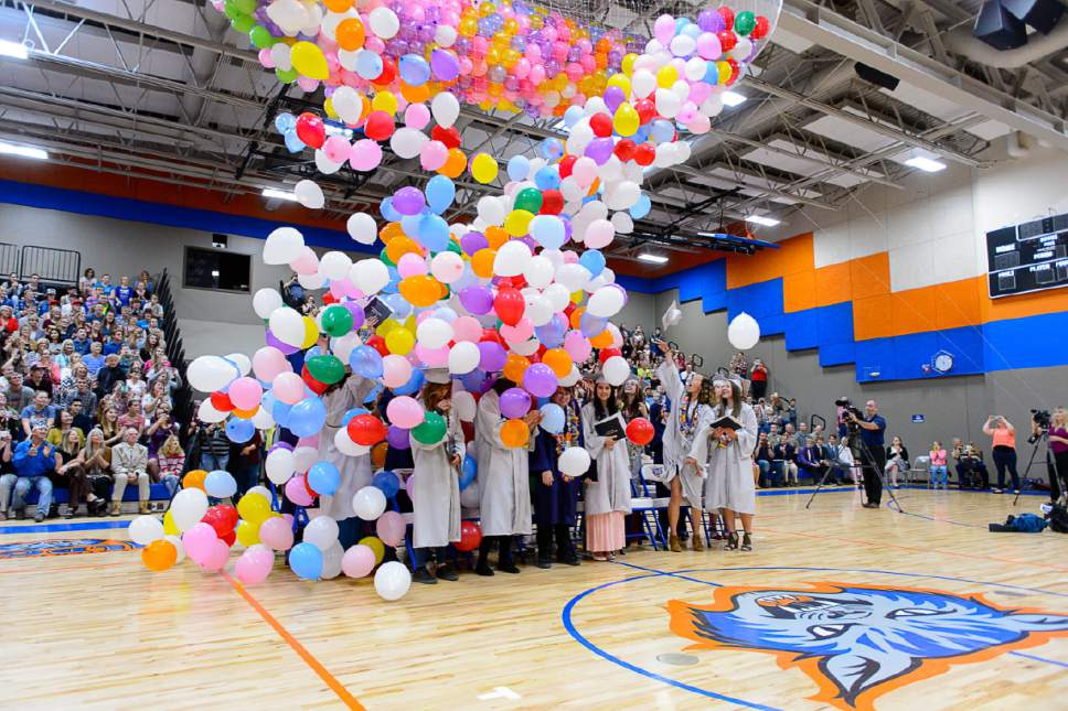 Trent Nelson  |  The Salt Lake Tribune Balloons fall on graduates at Water Canyon High School's graduation ceremony in Hildale, Monday May 22, 2017. Two years ago the school had one graduate, this year twenty-five.