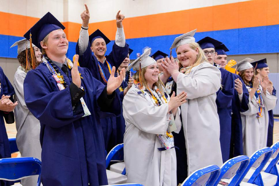 Trent Nelson  |  The Salt Lake Tribune Graduates acknowledge their families and supporters at Water Canyon High School's graduation ceremony in Hildale, Monday May 22, 2017. Two years ago the school had one graduate, this year twenty-five.