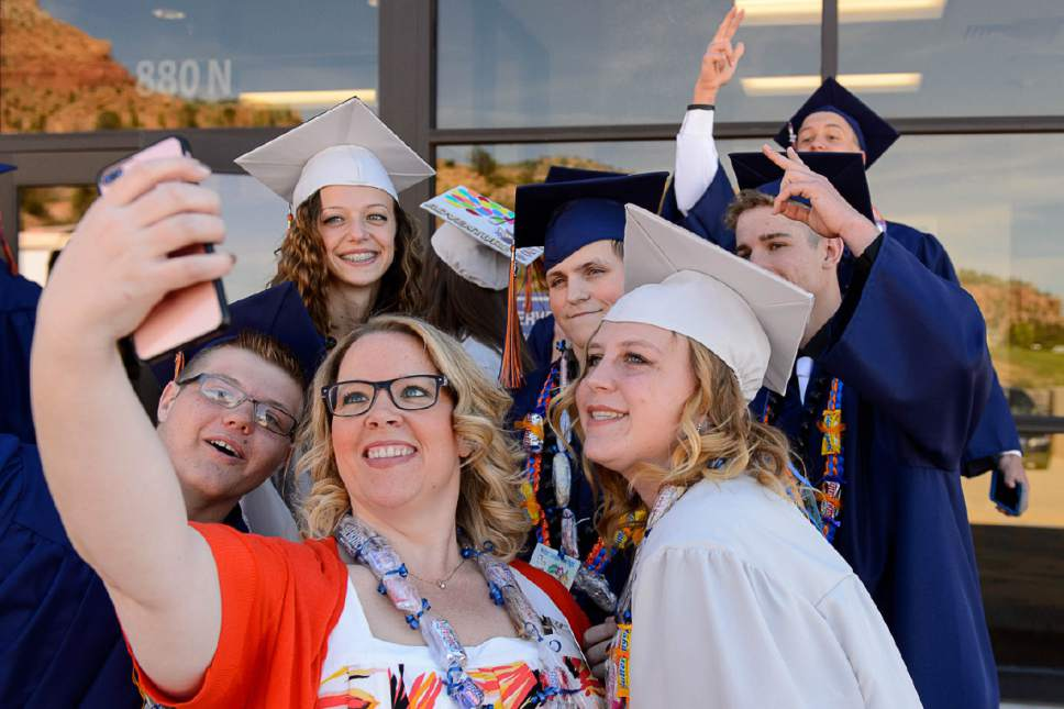 Trent Nelson  |  The Salt Lake Tribune Teacher Jessica Hammett takes a selfie with graduates at Water Canyon High School's graduation ceremony in Hildale, Monday May 22, 2017. Two years ago the school had one graduate, this year twenty-five.