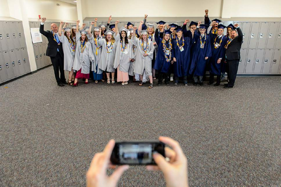 Trent Nelson  |  The Salt Lake Tribune The graduating class at Water Canyon High School poses for a photo before their graduation ceremony in Hildale, Monday May 22, 2017. Two years ago the school had one graduate, this year twenty-five.