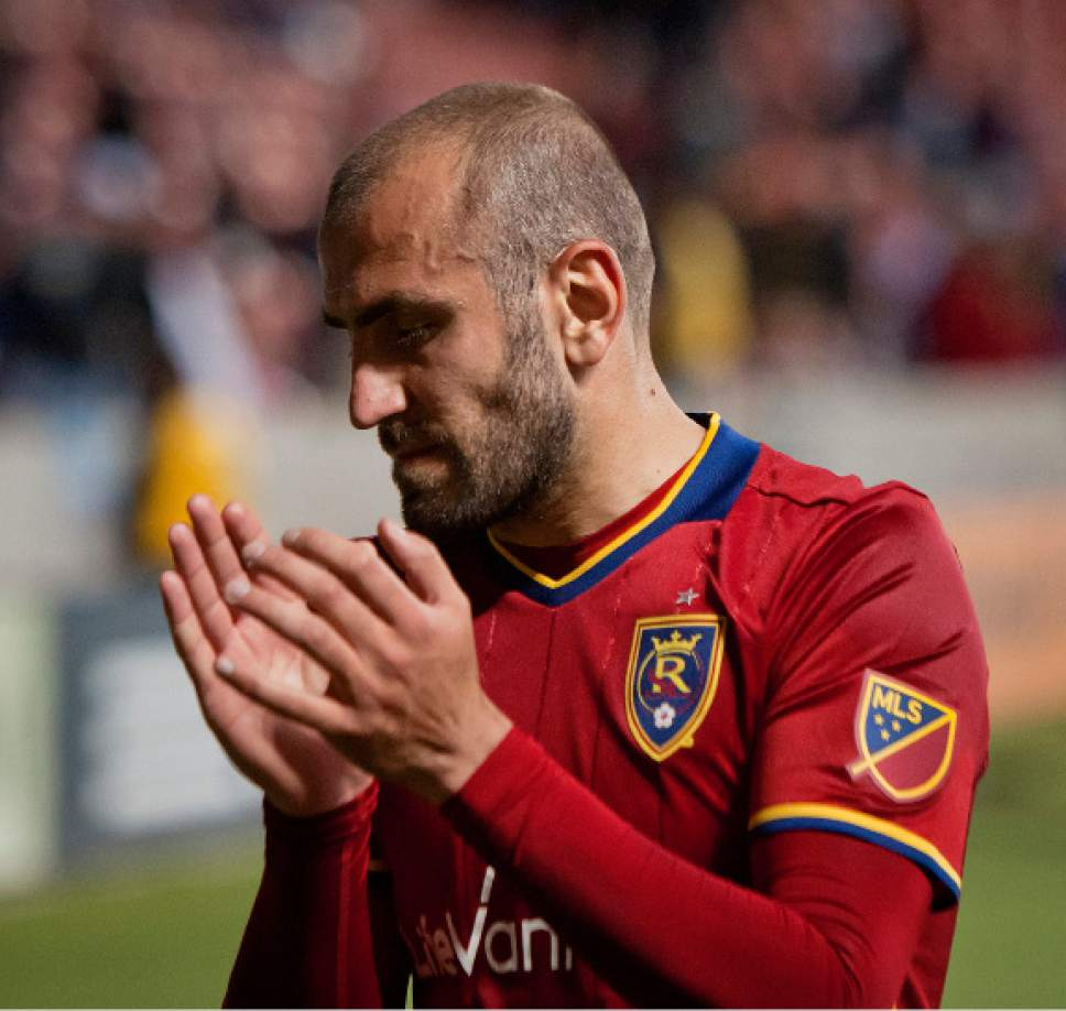 Michael Mangum  |  Special to the Tribune  Real Salt Lake forward Yura Movsisyan (14) sullenly applauds to the crowd following their 3-0 home loss to FC Dallas at Rio Tinto Stadium in Sandy, UT on Saturday, May 6, 2017.