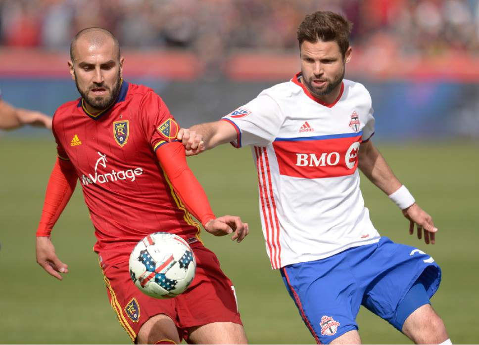 Leah Hogsten  |  The Salt Lake Tribune Real Salt Lake forward Yura Movsisyan (14) battles Toronto FC midfielder Michael Bradley (4). Real Salt Lake kicked off the 2017 season Saturday, March 4, 2017 with a home opener against Toronto FC at Rio Tinto Stadium. Real Salt Lake and Toronto FC are 0-0 at the half.