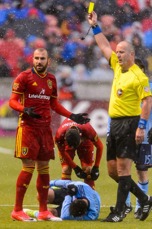 Trent Nelson  |  The Salt Lake Tribune Real Salt Lake forward Yura Movsisyan (14) gets a yellow card as New York City FC defender Alexander Callens (6) rolls on the ground. Real Salt Lake vs. New York City FC at Rio Tinto Stadium in Sandy, Wednesday May 17, 2017.