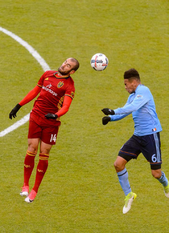 Trent Nelson  |  The Salt Lake Tribune Real Salt Lake forward Yura Movsisyan (14) heads the ball, with New York City FC defender Alexander Callens (6) at right. Real Salt Lake vs. New York City FC at Rio Tinto Stadium in Sandy, Wednesday May 17, 2017.