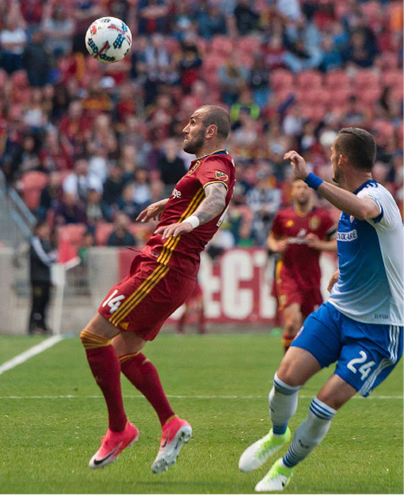 Michael Mangum  |  Special to the Tribune  Real Salt Lake forward Yura Movsisyan (14) eyes the ball as he tries to gain possession in front of FC Dallas defender Matt Hedges (24) during their match at Rio Tinto Stadium in Sandy, UT on Saturday, May 6, 2017.