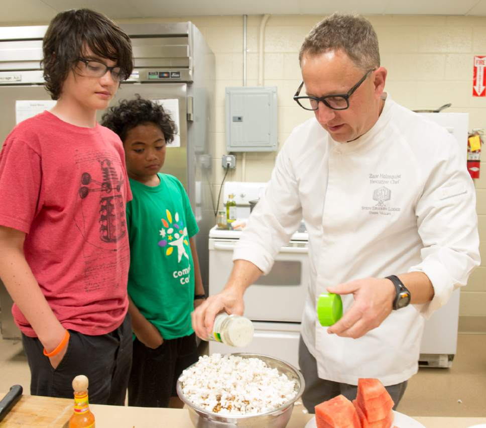 Rick Egan  |  The Salt Lake Tribune  Zane Holmquist, the chef at Stein Eriksen Lodge (right), teaches at a 2015 program sponsored by 3 Squares, a non-profit that works to improve food insecurity issues for Utah families.