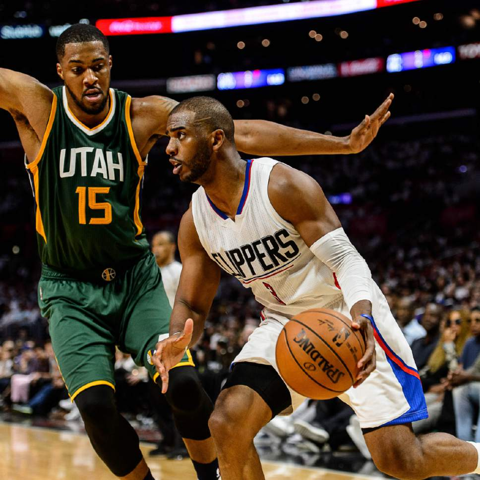 Trent Nelson     The Salt Lake Tribune LA Clippers guard Chris Paul (3) drives on Utah Jazz forward Derrick Favors (15) as the Utah Jazz face the Los Angeles Clippers in Game 7 at STAPLES Center in Los Angeles, California, Sunday April 30, 2017.