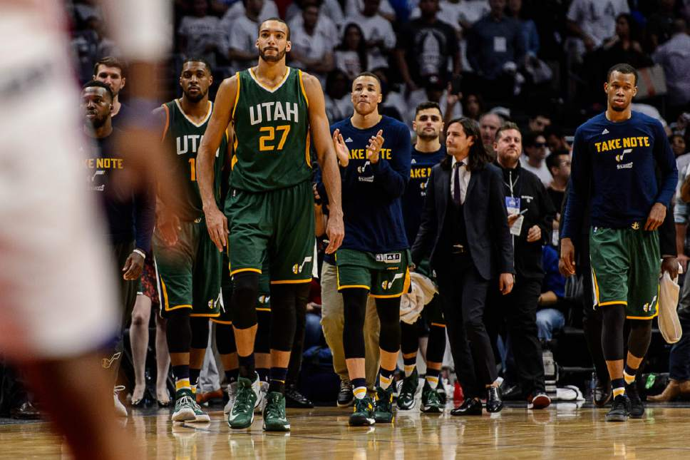 Trent Nelson     The Salt Lake Tribune Utah Jazz forward Derrick Favors (15) and Utah Jazz center Rudy Gobert (27) walk onto the court to celebrate the win as the Utah Jazz face the Los Angeles Clippers in Game 7 at STAPLES Center in Los Angeles, California, Sunday April 30, 2017.