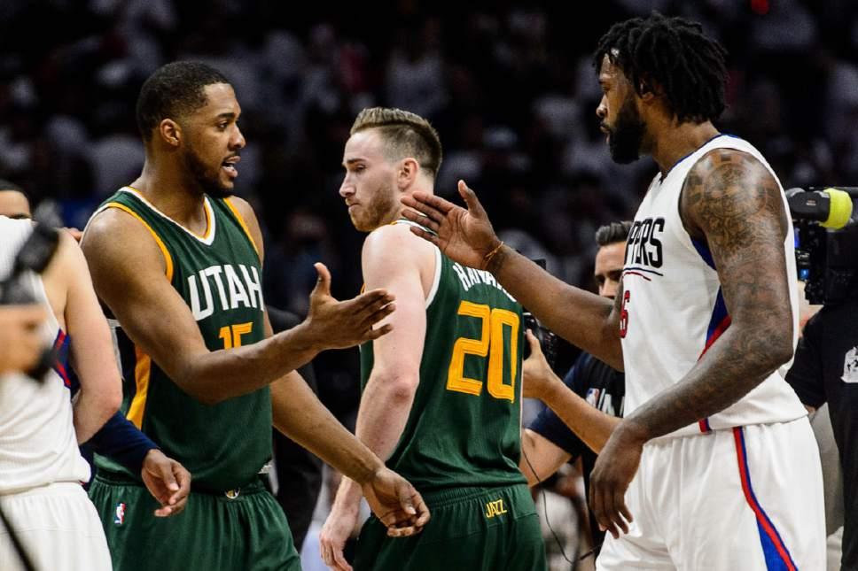 Trent Nelson     The Salt Lake Tribune Utah Jazz forward Derrick Favors (15) shakes hands with LA Clippers center DeAndre Jordan (6) after the game as the Utah Jazz defeat the Los Angeles Clippers in Game 7 at STAPLES Center in Los Angeles, California, Sunday April 30, 2017.