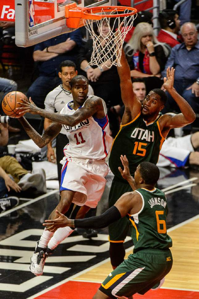 Trent Nelson     The Salt Lake Tribune LA Clippers guard Jamal Crawford (11) looks to pass, defended by Utah Jazz forward Joe Johnson (6) and Utah Jazz forward Derrick Favors (15), as the Utah Jazz face the Los Angeles Clippers in Game 7 at STAPLES Center in Los Angeles, California, Sunday April 30, 2017.