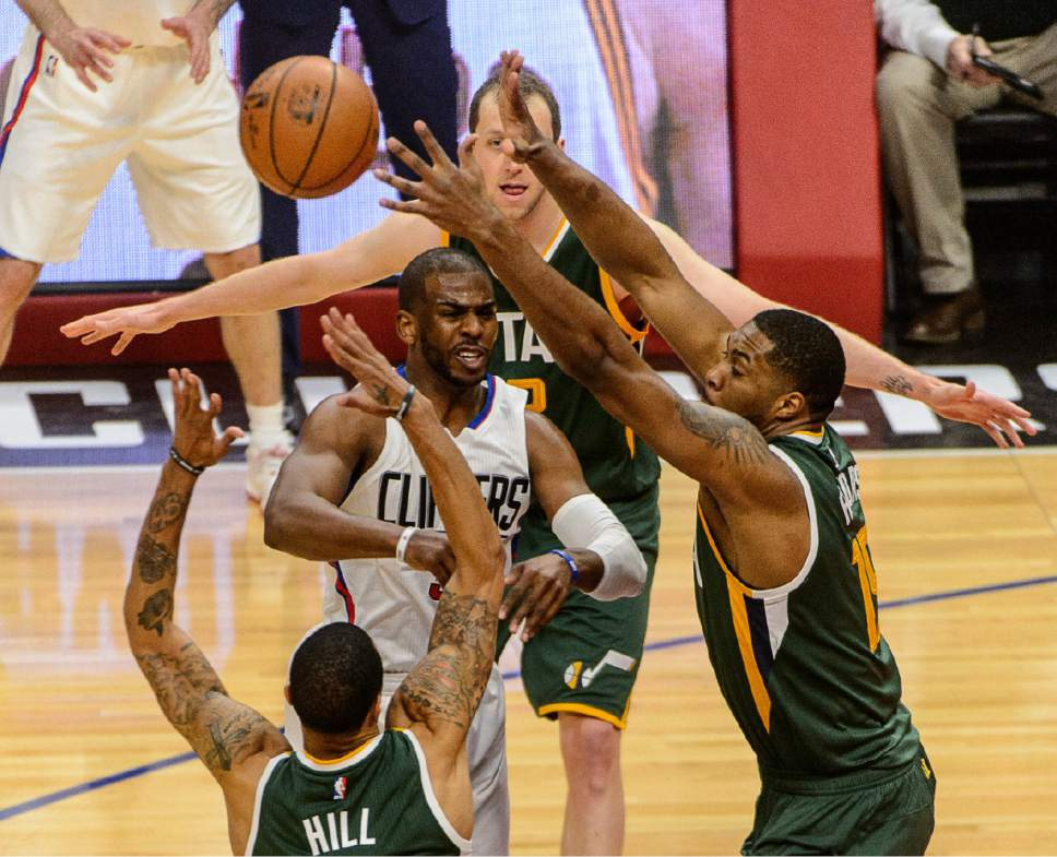 Trent Nelson     The Salt Lake Tribune LA Clippers guard Chris Paul (3) passes through the arms of Utah Jazz guard George Hill (3) and Utah Jazz forward Derrick Favors (15) as the Utah Jazz face the Los Angeles Clippers in Game 7 at STAPLES Center in Los Angeles, California, Sunday April 30, 2017.