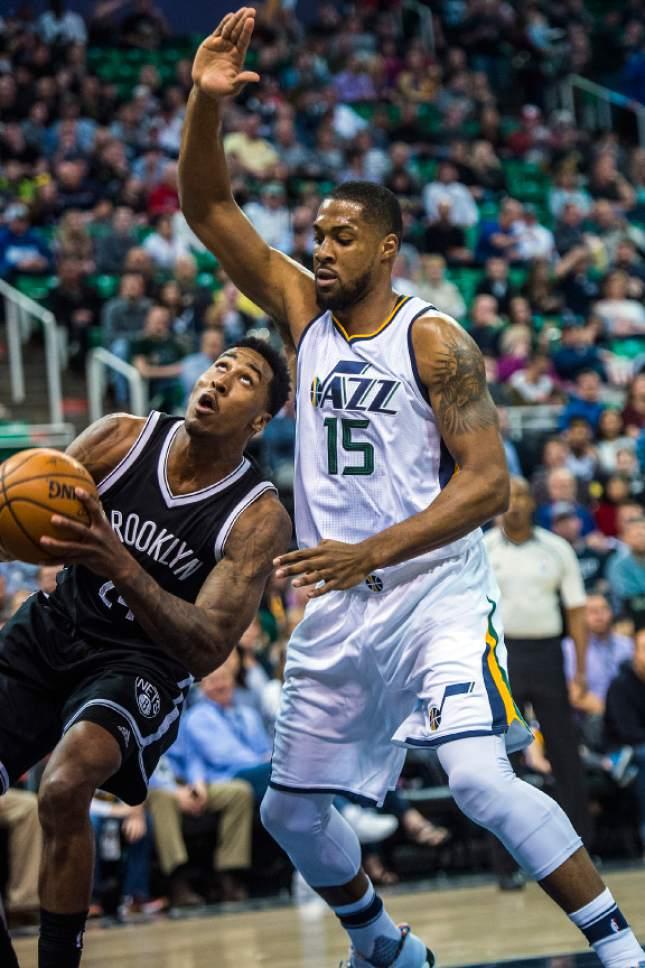 Chris Detrick     The Salt Lake Tribune Utah Jazz forward Derrick Favors (15) guards Brooklyn Nets forward Rondae Hollis-Jefferson (24) during the game at Vivint Smart Home Arena Friday March 3, 2017.