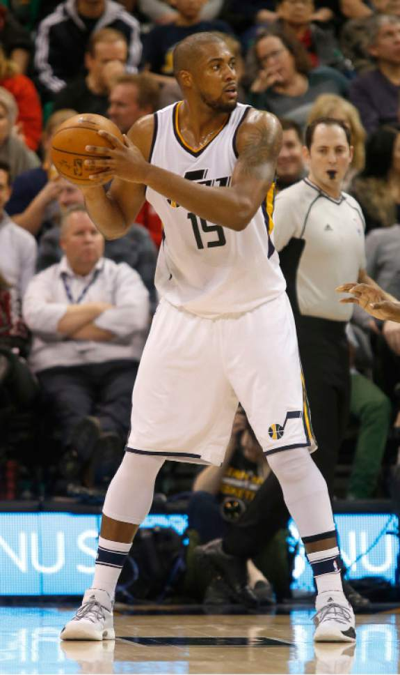 Utah Jazz forward Derrick Favors (15) looks to pass the ball during the first half of an NBA basketball game against the Indiana Pacers, Saturday, Jan. 21, 2017, in Salt Lake City. (AP Photo/George Frey)