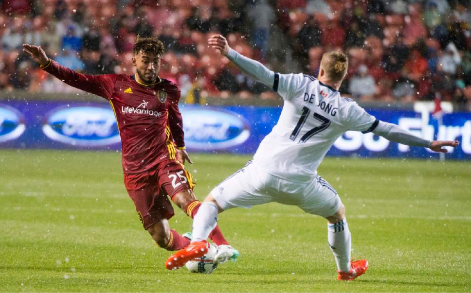Rick Egan  |  The Salt Lake Tribune  Real Salt Lake midfielder Danilo Acosta (25) tries to get the ball past Vancouver defender,Nicolas Mezquida (11), in MLS action, at Rio Tinto Stadium, Saturday, April 8, 2017.