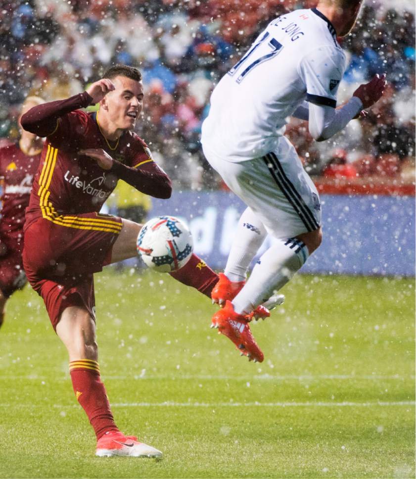 Rick Egan  |  The Salt Lake Tribune  Real Salt Lake midfielder Sebastian Saucedo (23) kicks the ball, as Vancouver Whitecaps defender Marcel de Jong (17) defends,  in RSL action at Rio Tinto Stadium, Saturday, April 8, 2017.