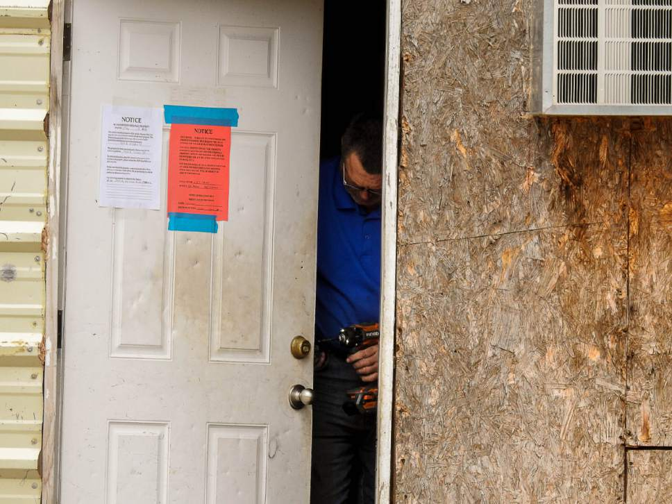 Trent Nelson  |  The Salt Lake Tribune Locksmith Kelvin Holdaway changes the locks on a UEP Trust property in Hildale, Tuesday May 9, 2017.
