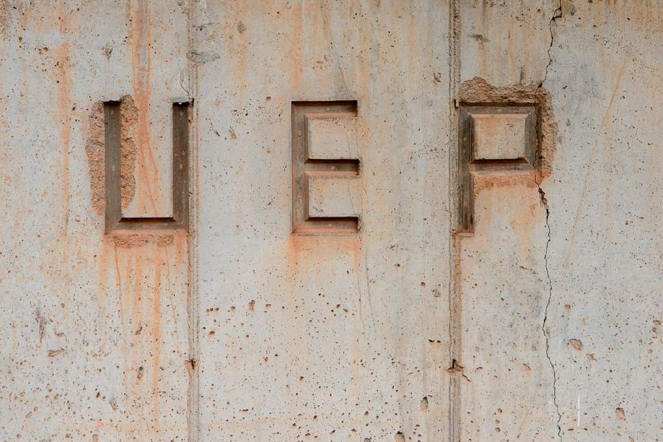 Trent Nelson  |  The Salt Lake Tribune UEP - United Effort Plan - engraved into a concrete wall in Colorado City, Ariz., Tuesday May 9, 2017.