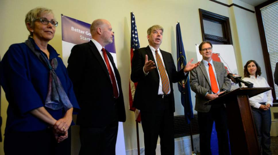 Steve Griffin  | Tribune file photo Jim Bennett, center, amid members of the new United Utah Party, at the centrist political party's launch in May.  The party has sued in federal court, claiming state rules are unfairly blocking its ballot access.