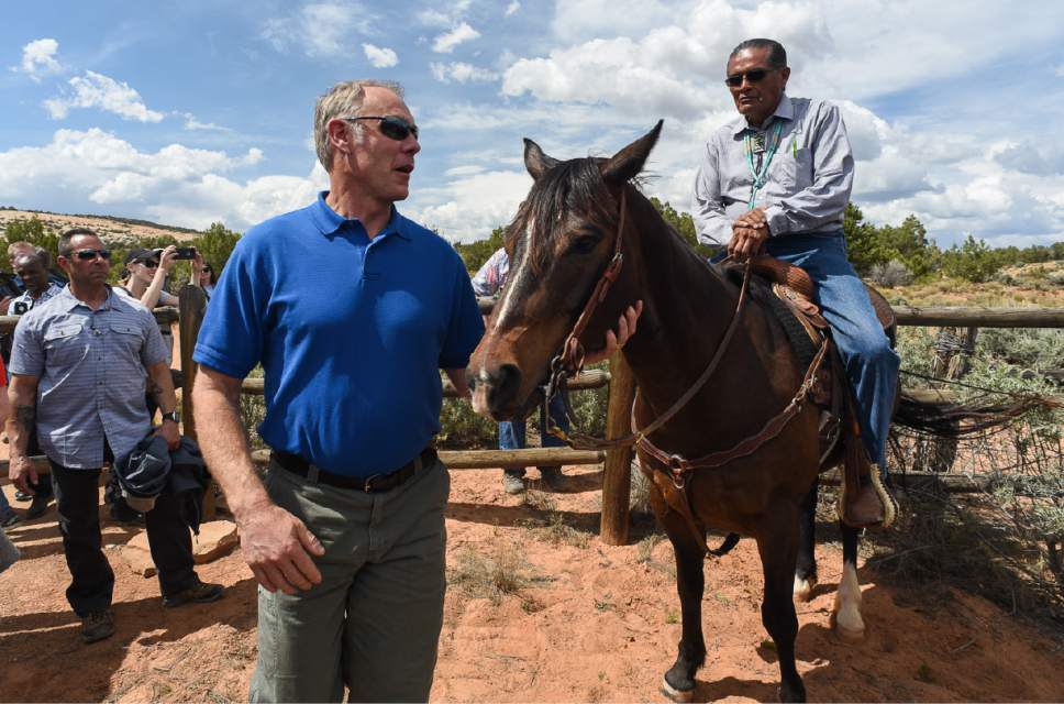 Francisco Kjolseth | The Salt Lake Tribune Interior Secretary Ryan Zinke stops to meet Hank Stevens, Navajo Mountain Chapter President at the Butler Wash Indian Ruins trailhead as Secretary Zinke toured Bears Ears National Monument on Monday, May 8, 2017, during a review tour ordered by President Trump.