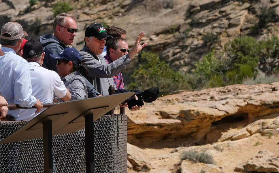 Francisco Kjolseth | The Salt Lake Tribune Interior Secretary Ryan Zinke is joined by San Juan County Commission Chairman Phil Lyman as he overlooks the Butler Wash Indian Ruins within the Bears Ears National Monument on Monday, May 8, 2017.