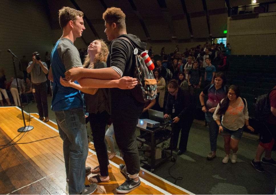 Leah Hogsten     The Salt Lake Tribune   Charlie Scriver's friends and classmates at Bennion Junior High rush to the stage to congratulate Scriver, left, Thursday, May 25, 2017, after he was awarded Granite School District's Absolutely Incredible Kid Award – an annual recognition that shines a spotlight on those who rise above hardships in their lives to learn, serve and succeed.