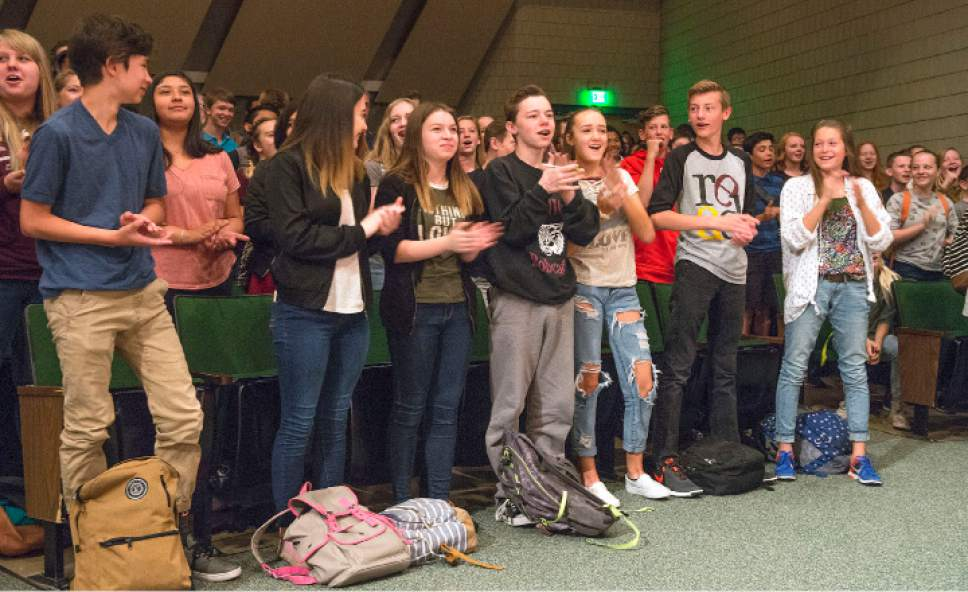Leah Hogsten     The Salt Lake Tribune l-r  Charlie Scriver's friends and classmates at Bennion Junior High erupt in cheers and applause after Charlie takes the stage to be presented with gifts, Thursday, May 25, 2017. Charlie Scriver was awarded Granite School District's Absolutely Incredible Kid Award – an annual recognition that shines a spotlight on those who rise above hardships in their lives to learn, serve and succeed.