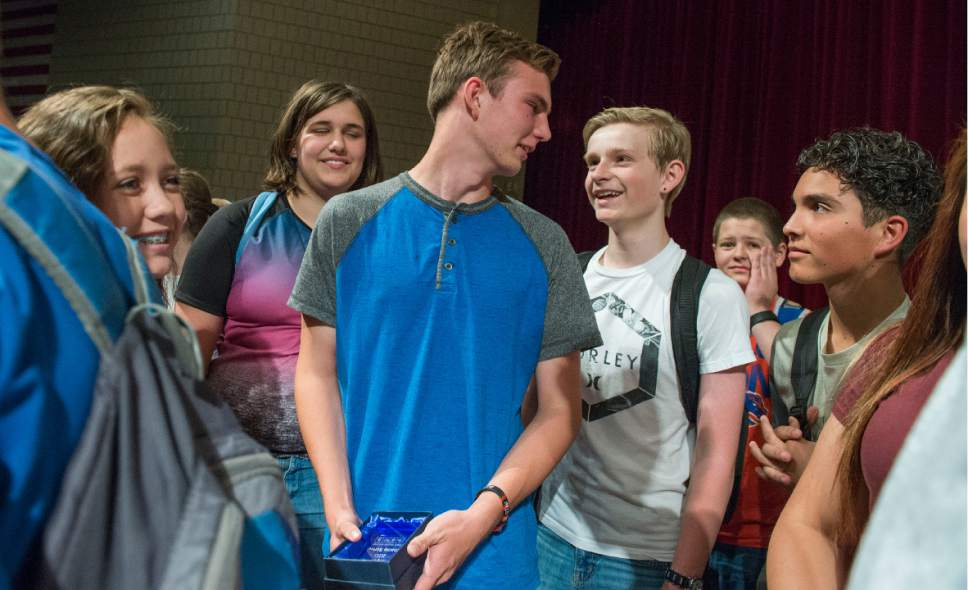Leah Hogsten     The Salt Lake Tribune  Charlie Scriver's friends and classmates at Bennion Junior High rush to the stage to congratulate Scriver, center, Thursday, May 25, 2017, after he was awarded Granite School Districtís Absolutely Incredible Kid Award ñ an annual recognition that shines a spotlight on those who rise above hardships in their lives to learn, serve and succeed.