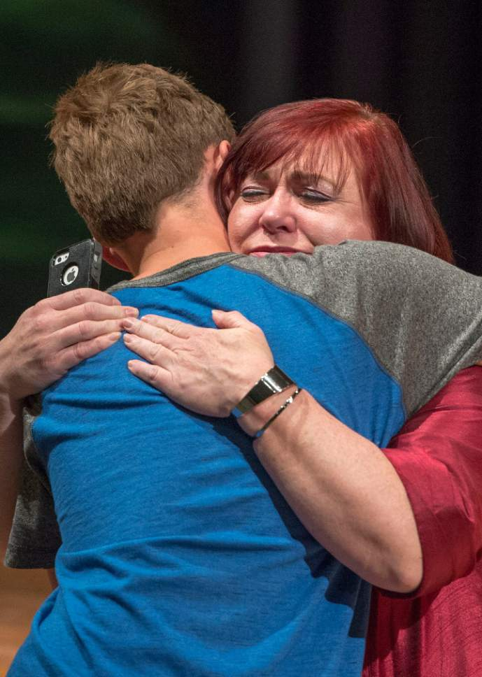 Leah Hogsten     The Salt Lake Tribune Charlie Scriver hugs his Bennion Junior High School counselor Christi Reed. Thursday, May 25, 2017. Charlie Scriver was awarded Granite School District's Absolutely Incredible Kid Award – an annual recognition that shines a spotlight on those who rise above hardships in their lives to learn, serve and succeed.