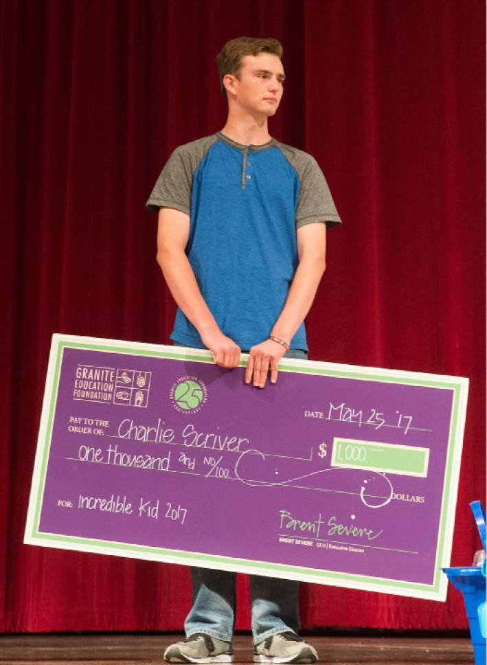 """Leah Hogsten     The Salt Lake Tribune Bennion Junior High School student  Charlie Scriver is presented with multiple gifts including a $1,000 check from Granite School District,Thursday, May 25, 2017, during his """"Absolutely Incredible Kid Award.""""  Charlie Scriver was awarded Granite School District's Absolutely Incredible Kid Award – an annual recognition that shines a spotlight on those who rise above hardships in their lives to learn, serve and succeed."""