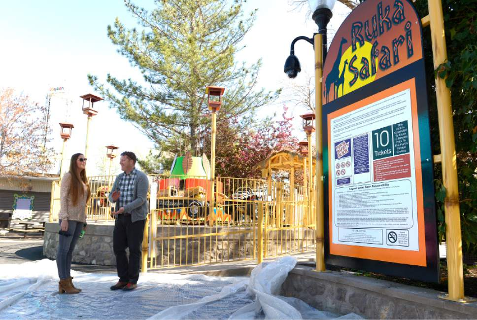 Leah Hogsten  |  The Salt Lake Tribune  Third-generation Lagoon owner Julie Freed, left, and Adam Leishman with media relations discuss one of two new ride at the park's Kiddie Land. The Ruka Safari (right) will be unveiled this year.